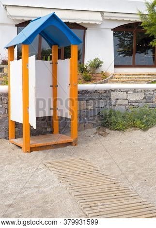 An Old Changing Booth On The Beach