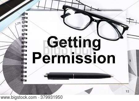 Getting Permission. The Text Is Written On White Paper. Near Financial Charts, Glasses Pens, Calcula