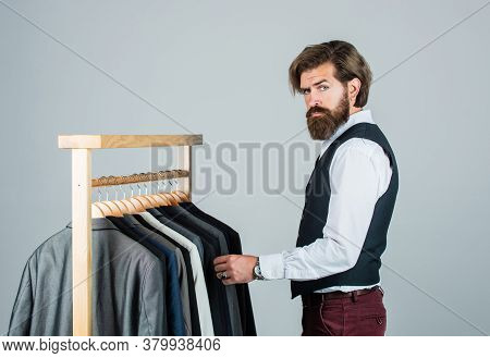 Man In Custom Tailored Suit Presenting Expensive Tailored Tuxedo. Man In Boutique. Man With Suit. Ta