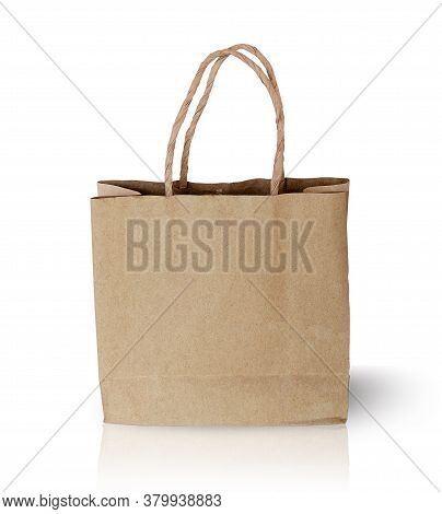 Brown Kraft Paper Bag Isolated On White Background With Clipping Paths For Graphic Design. Container