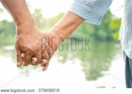 Asian Elderly Couple Holding Hands Together, Love Each Other And Take Care Of Each Other Forever. Th