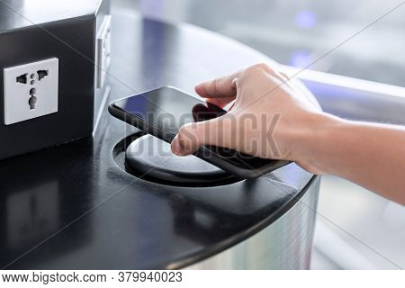 Woman Hands Charging Battery In Mobile Smart Phone By Wireless Charger At International Airport Term