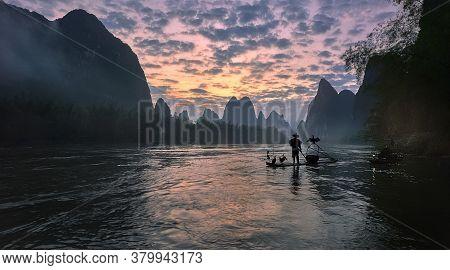 Asian Man Rowing On Wooden Boat, A Man Rows Thai Wooden Boat, Amphawa, Samutsongkham, Thailand