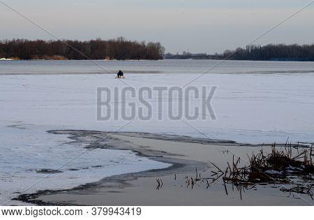 Winter Fishing On A Frozen River Dnieper
