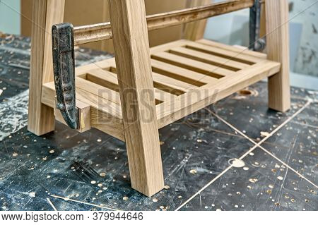 Joinery. Gluing And Clamping Wooden Table Leg. Wooden Furniture Manufacturing Process. Furniture Man