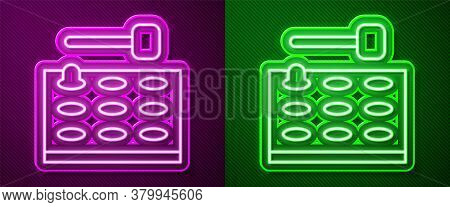 Glowing Neon Line Arcade Game Machine With Hammer Icon Isolated On Purple And Green Background. Amus