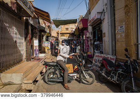 Rajasthan / India - July 22 2020 : Man Turning His Bike In The Market And Blocks Road