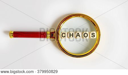 Wooden Blocks With The Text: Chaos On A Magnifying Glass.