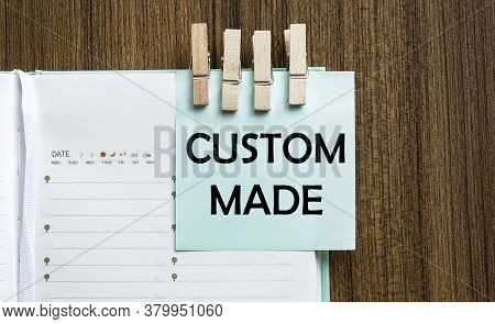 Custom Made Notes Paper And A Clothes Pegs On Wooden Background