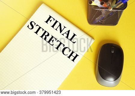 Computer Mouse, Pens, Felt-tip Pens, Notepad With Text Final Stretch On A Yellow Background
