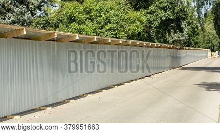 Grey Metal Fence Enclosing A Construction Site
