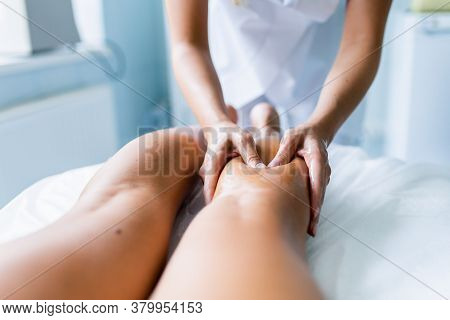 Womens Hands Massage The Athletes Legs And Shins After The Competition. Sports Massage, Recovery. Sp