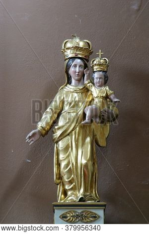 NOVALJA, CROATIA - SEPTEMBER 17, 2014: Virgin Mary with baby Jesus statue on the altar at St. Catherine's Church in Novalja, Croatia