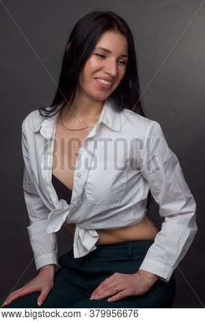 Portrait Of A Brunette In A White Knotted Shirt