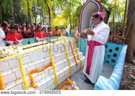 KUMROKHALI, INDIA - FEBRUARY 23, 2020: Bishop Shyamal Bose leads prayer at the tomb of Croatian missionary, Jesuit father Ante Gabric on the occasion of his 105th birthday in Kumrokhali, West Bengal