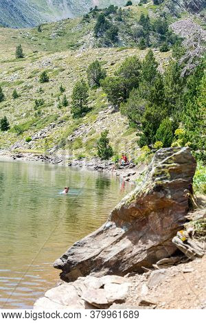 Coma Pedrosa, Andorra : 02 August 2020 : \rgroup Of Tourists Resting At Lago De Les Truites In Andor