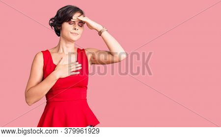 Beautiful young woman with short hair wearing casual style with sleeveless shirt touching forehead for illness and fever, flu and cold, virus sick