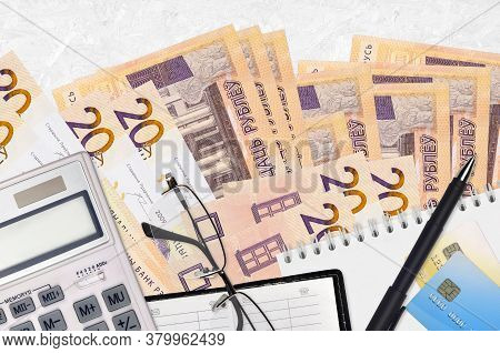 20 Belorussian Rubles Bills And Calculator With Glasses And Pen. Tax Payment Concept Or Investment S