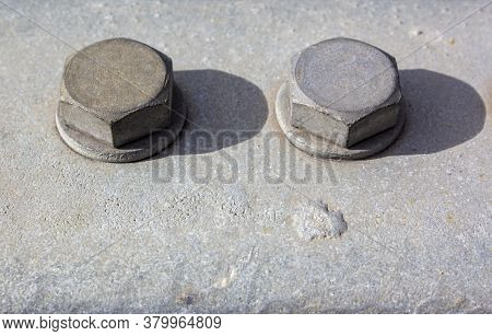 Large Head Bolts On Metal Construction As Background - Engineering Concept. Metal Heads Of Two Bolts