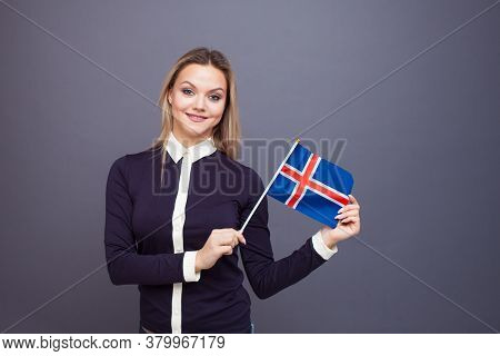 Immigration And The Study Of Foreign Languages, Concept. A Young Smiling Woman With A Iceland Flag I