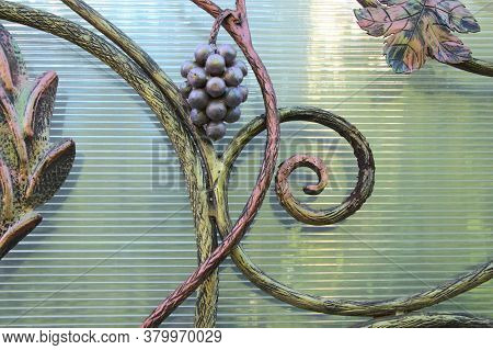 Iron Forging On The Door, With A Vine Texture Background. Beige Gate, With Ornate Rods. Texture For
