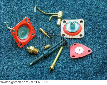Car Parts Close-up. New Carburetor Parts Are On The Table. Car Repair. Vehicle Maintenance.