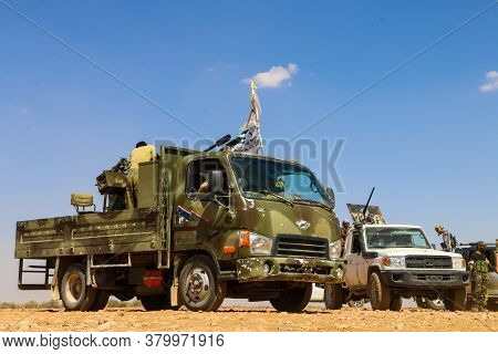 Soldiers Stands On An Armored Vehicle Weapon And Targets With The Artillery Tank Machine Gun Ready F