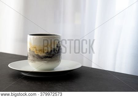A Coffee Cup Placed On A White Saucer Placed On A Dark Stone Table With Copy Space