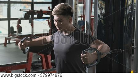 Athlete Sportsman Workout Exercise Muscle Chest With Machine Bodybuilding At Fitness Gym Healthy Lif