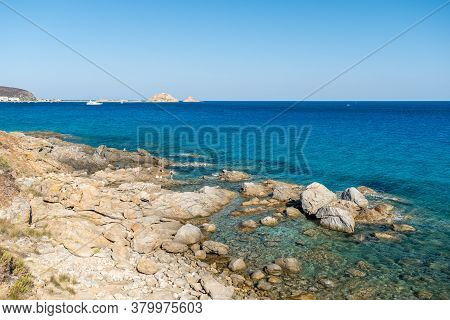 L'ile Rousse, Corsica, France - 8th August 2020. A Family Are Fishing In The Translucent Mediterrane