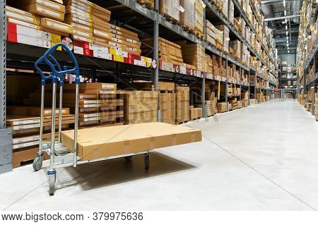 Warehouse Logistics - Box On Trolley In Modern Distribution Center