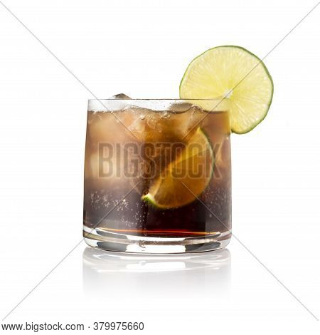Cuba Libre Cocktail With Brown Rum, Lemon Juice, Coke And Ice Cubes, Decorated With Fresh Lime Slice