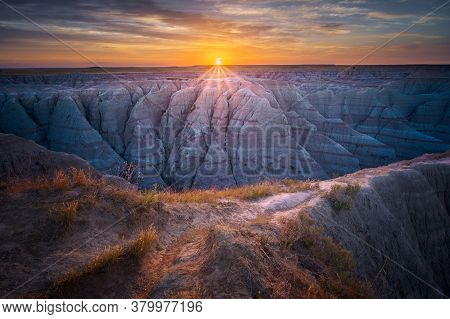 Magnificent Sunrise Over Colorful Rock Formations In South Dakota
