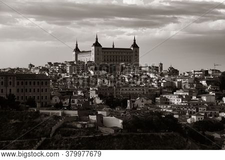 Toledo Castle of San Servando rooftop view with historical buildings in Spain.