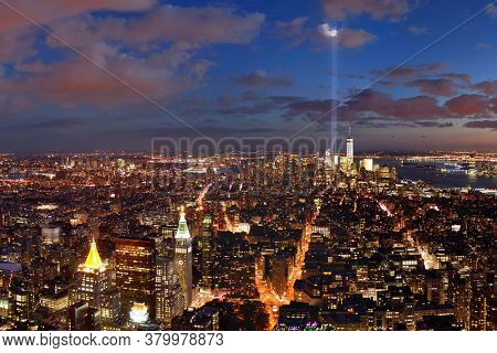 New York City downtown skyline night view and 911 tribute light.