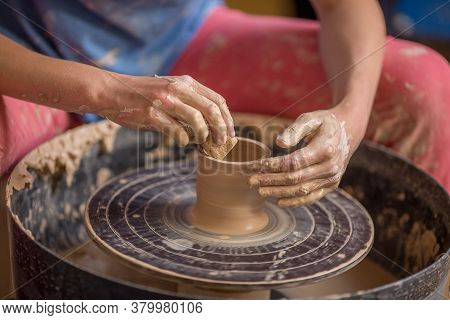Closeup Shot Of Female Ceramic Artist Works On Pottery Wheel In Studio Space, Creative People Handcr