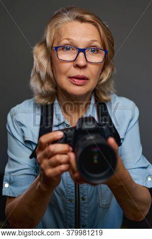 Mature Woman Photographer Is Taking Images With Dslr Camera