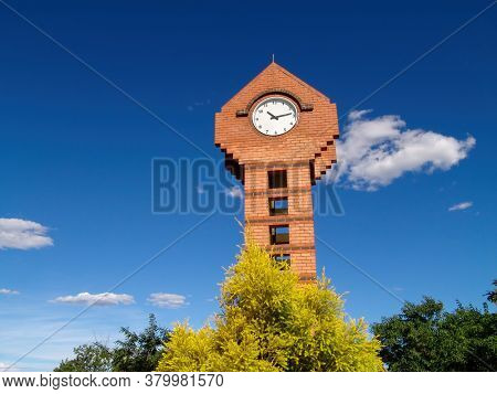 clocktower in town against the blue sky