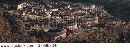FUJIAN, CHINA – MARCH 2, 2018: Panorama view of a group of Tulou. Tulou is the unique traditional rural dwelling of Hakka.