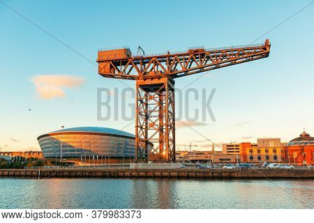 GLASGOW, UK - FEB 26, 2020: The Finnieston Crane or Stobcross Crane stand at waterfront of city center in Scotland, United Kingdom as the symbol of engineering heritage