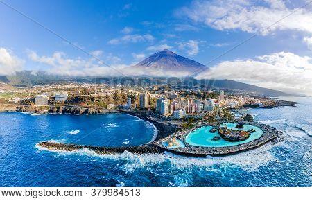 Aerial View With Puerto De La Cruz, In Background Teide Volcano, Tenerife Island, Spain