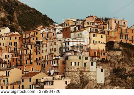 Italian style resident buildings over cliff in Manarola in Cinque Terre, Italy.