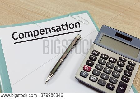 Compensation Claim Concept - Document With The Title - Compensation - Alongside A Calculator