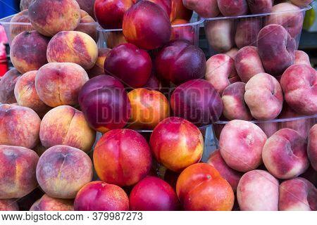 Fresh Sweet Ripe Peaches As Background. A Heap Of Ripe Peaches (prunus Persica) Close-up