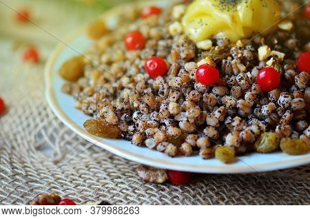Sweet Pilaf With Dried Fruits. Plate With Kutia With Dried Fruits.