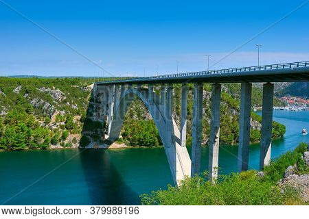 Sibenik Bridge Across Canyon Of The Krka River. Panoramic View Towards Scradin Town.
