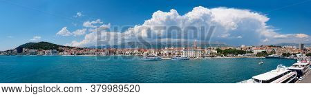 Split City In Dalmatia, Croatia On A Bright Day With Clouds. Panoramic Image Of Harbor With Passenge