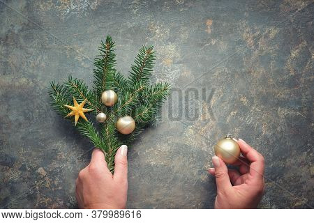 Christmas Decorations, Flat Lay With Hands Holding Fir Twigs Decorated With Golden Trinkets, Baubles