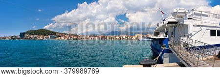 Split Harbor With Passenger Ships. Split City In Dalmatia, Croatia On A Bright Day With Clouds.
