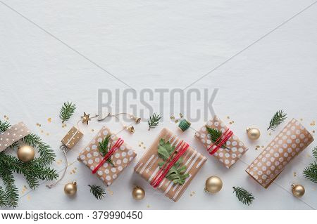 Diy Christmas Gifts In Craft Wrapping Paper, Handmade Decorations. Flat Lay On White Soft Textile Ta